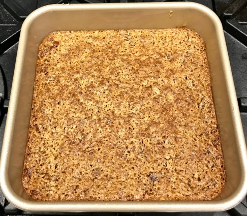 pecan coconut bars finished with topping in pan
